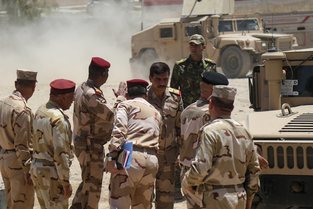Iraqi army leaders arrive during a reconnaissance for a new tactical assembly area, near Mosul, Iraq, June 7, 2017. The Iraqi commanders met with U.S. Army Soldiers deployed in support of Combined Joint Task Force - Operation Inherent Resolve and assigned to 2nd Brigade Combat Team, 82nd Airborne Division, whose mission is to enable their Iraqi security force partners through the advise and assist mission, contributing planning, intelligence collection and analysis, force protection, and precision fires to achieve the military defeat of ISIS. CJTF-OIR is the global Coalition to defeat ISIS in Iraq and Syria. (U.S. Army photo by Staff Sgt. Jason Hull)