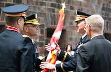 Brig. Gen. William H. Graham, Commanding General, Army Corps' North Atlantic Division, (left) passes the Army Corps flag to Col. Thomas Asbery, New York District's 53rd Commander, as the outgoing Commander, Col. David Caldwell and Joseph J. Seebode, New York District's DPM look on. The event was held June 8, 2017 on Governors Island, New York City.