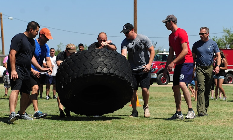 The Abilene Fire Department team flips a tire during Battle of the Badges at Dyess Air Force Base, Texas, June 10, 2017. Battle of the Badges is an event which brings together emergency response forces from Abilene and Dyess AFB to build comradery and partnership. (U.S. Air Force photo by Airman 1st Class April Lancto)