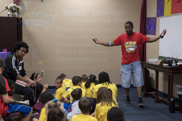 Tech. Sgt. Justin Baskerville, 823d Base Defense Squadron NCO in charge of logistics, teaches children during the base chapel's Vacation Bible School, June 7, 2017 at Moody Air Force Base, Ga. More than 80 people volunteered for this year's VBS and 105 children attended. (U.S. Air Force photo by Tech. Sgt. Zachary Wolf)