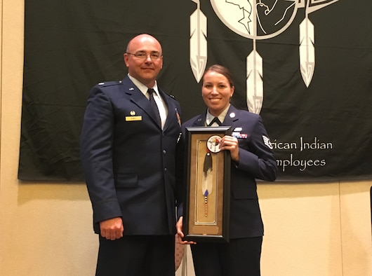 U.S. Air National Guard Staff Sgt. Trisha Ross and Lt. Col. Brandon East display the award Ross received from SAIGE for Meritorious Military Service during a ceremony held on June 8, 2017 in Scottsdale, Ariz. Ross is assigned to the Security Forces Squadron with the Iowa Air National Guard's 185th Air Refueling Wing in Sioux City, Iowa. (Courtesy Photo from Staff Sgt. Ross)