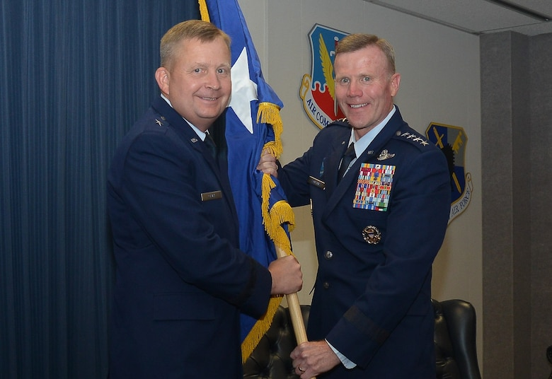 "On June 8, Brig. Gen. James R. ""Cliffy"" Cluff, vice commander, 25th Air Force, accepts his general officer flag from Gen. Tod D. Wolters, commander, U.S. Air Forces in Europe, U.S. Air Forces Africa and Allied Air Command; and director, Joint Air Power Competence Centre, after his promotion. Cluff is responsible to the 25th Air Force commander for providing multisource Intelligence, Surveillance and Reconnaissance products, applications, capabilities and resources; electronic warfare; and integrating cyber ISR forces and expertise."