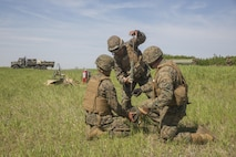 COLD LAKE, AB, CANADA – Cpl. Yasuey Gonzalez (left), Pfc. Robert Garcia (center), and Staff Sgt. Brian Beamer (right), bulk fuel specialists with Marine Wing Support Squadron 473, 4th Marine Aircraft Wing, Marine Forces Reserve, hammer a grounding rod into the earth at the Canadian Manoeuvre Training Centre during exercise Maple Flag 50, May 31, 2017. MWSS-473 is providing real world refueling support to Royal Canadian Air Force CH-147 Chinook and CH-146 Griffon type model series during exercise Maple Flag 50. (U.S. Marine Corps photo by Lance Cpl. Niles Lee/Released)