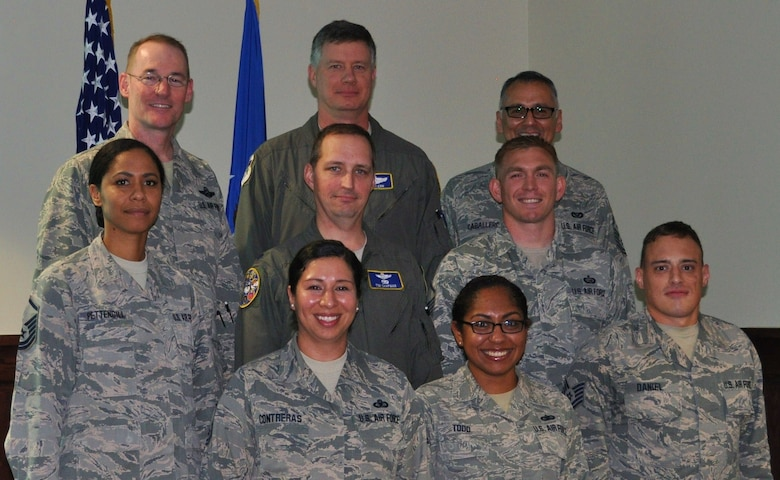 Col. Roger Suro, 340 Flying Training Group Commander (Top left), poses for a photo with members of the Group's Undergraduate Flight Training team to celebrate their receipt of the Air Force Reserve Command's Gen. George Kenny Lessons Learned Award. The award was presented during the unit's spring MUTA held June 8-9 at Joint Base San Antonio-Randolph, Texas. Other members pictured are (top back row-center) Lt. Col. Lee Glenn, Senior Master Sgt. Samuel Caballero. (middle row l-r) Master Sgt. Tainell Pettengill, Lt. Col. Timothy Chapman and Master Sgt. Randy Alvis. (Front row) Master Sgt. Vianca Contreras, Tech. Sgt. Natasha Todd and Tech. Sgt. Brett Daniel. (Photo by Janis El Shabazz, 340 FTG Public Affairs).