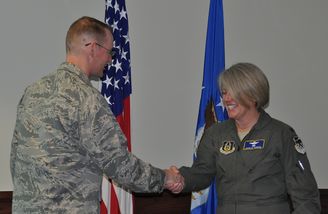 Col. Roger Suro, 340 Flying Training Group Commander, coins Lt. Col. Charlan Poirson at Joint Base San Antonio-Randolph, Texas.  Poirson was celebrated during the unit's MUTA, June 8-9 in recognition of her being named to the Key Personnel List and for her service as the Group's Deputy Commander. She will soon depart for a new position working for Brig. Gen. Ellen Moore at the Air Reserve Personnel Center. (Photo by Janis El Shabazz, 340 FTG Public Affairs).