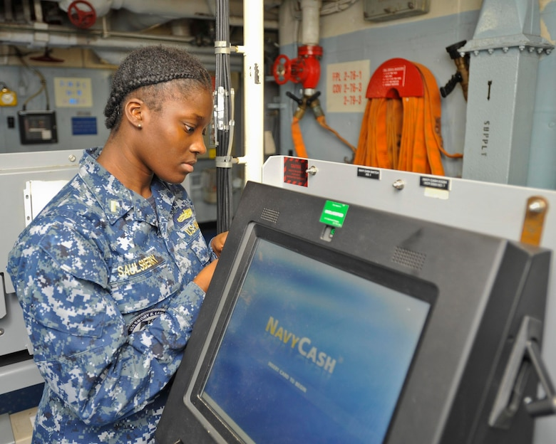 (POLARIS POINT, Guam) May 23, 2017 -- Ens. Brittany Saulsberry, disbursing officer aboard submarine tender USS Emory S. Land (AS 39), opens the front panel of one of the ship's Navy Cash devices. Saulsberry was recently selected to serve as a supply officer aboard submarines as part of the Women in Submarine Service program. Land and sister ship USS Frank Cable (AS 40) provide maintenance, hotel services, and logistical support to submarines and surface ships in the U.S. 5th and 7th Fleet areas of operation. (U.S. Navy photo by Mass Communication Specialist 2nd Class Richard A. Miller/RELEASED)