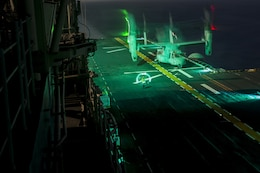 An MV-22B Osprey tiltrotor aircraft lands aboard the USS Bonhomme Richard (LHD 6) during nighttime flight operations. The Osprey belongs to Marine Medium Tiltrotor Squadron 265 (Reinforced). Marine aviators with VMM-265 (Rein.) and Marine Attack Squadron 311 (VMA-311), which combine to form the Aviation Combat Element of the 31st Marine Expeditionary Unit, refined their nighttime takeoff and landing capabilities during the training. The 31st MEU partners with the Navy's Amphibious Squadron 11 to form the amphibious component of the Bonhomme Richard Expeditionary Strike Group. The 31st MEU and PHIBRON 11 combine to provide a cohesive blue-green team capable of accomplishing a variety of missions across the Indo-Asia-Pacific region.
