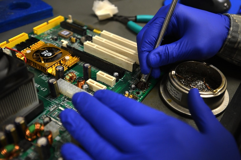 U.S. Air Force Staff Sgt. Alexander Creznic, 20th Maintenance Group Air Force Repair Enhancement Program (AFREP) technician, uses a wire brush to clean a capacitor removed from a computer's motherboard at the AFREP work center at Shaw Air Force Base, S.C., June 12, 2017. The savings from this flight's services have funded projects such as the 20th Component Maintenance Squadron paint booth and sun shades for Shaw's 79 F-16CM Fighting Falcons.   (U.S. Air Force photo by Airman 1st Class Christopher Maldonado)