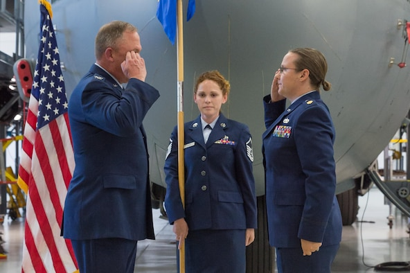 U.S. Air Force Col. Pete Linde, 153rd Maintenance Group commander, returns a salute from incoming 153rd Aircraft Maintenance Squadron commander Maj. Elizabeth Evans during an assumption of command ceremony June 10, 2017 in Cheyenne, Wyoming. Evans previously held the position of 153rd Maintenance Operations Flight commander. (U.S. Air National Guard photo by Senior Master Sgt. Charles Delano/released)
