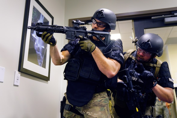 C. Donatell and M. Miller, both El Paso County Sheriff's Office Special Weapons and Tactics deputies, clear a building during an active shooter exercise at Schriever Air Force Base, Colorado, Wednesday, June 7, 2017. Opinicus Vista 17-2, which ran May 30-June 8, is Schriever's largest exercise of the year and coordinated efforts between Schriever Air Force Base and local area first responders to engage a wildfire and active shooter with a hostage scenario. (U.S. Air Force photo/Dennis Rogers)
