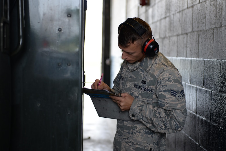U.S. Air Force Senior Airman Mark Timson, a 354th Logistics Readiness Squadron fuels preventative maintenance personnel, performs daily checks on an R-11 June 12, 2017, at Eielson Air Force Base, Alaska. Timson performed a preventative maintenance check on a fuel truck to ensure all parts were functional before being dispatched to the flight line during RED FLAG-Alaska 17-2. (U.S. Air Force photo by Airman 1st Class Cassandra Whitman)