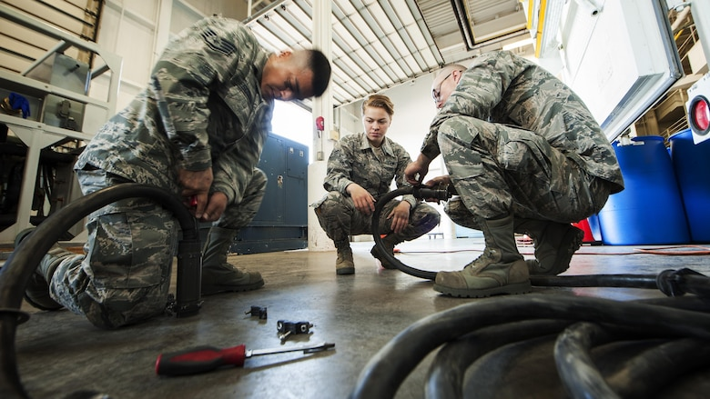 Members of the 91st Maintenance Group power, refrigeration, electrical, laboratory Global Strike Challenge team, disassemble electrical cables at Minot Air Force Base, N.D., May 30, 2017. Berthiaume helps prepare the team for Global Strike Challenge by simulating maintenance troubleshooting scenarios. (U.S. Air Force photo/Senior Airman J.T. Armstrong)