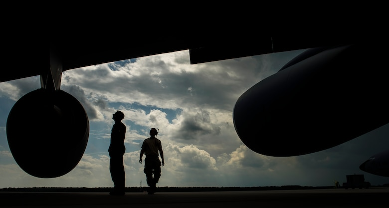Capt. Cody Jordan, left, 351st Air Refueling Squadron pilot, conducts a pre-flight inspection on a KC-135R Stratotanker with Master Sgt. Jacob Wavrin, right, 459th Aircraft Maintenance Squadron crew chief, during BALTOPS exercise at Powidz Air Base, Poland, June 12, 2017. The exercise is designed to enhance flexibility and interoperability, to strengthen combined response capabilities, as well as demonstrate resolve among Allied and Partner Nations' forces to ensure stability in, and if necessary defend, the Baltic Sea region. (U.S. Air Force photo by Staff Sgt. Jonathan Snyder)