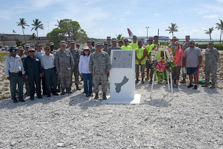 Attendees pose for a group photo during Wake Island's Guam Memorial rededication ceremony June 8, 2017. The Guam Memorial on Wake Island was erected in 1991 to honor 45 Chamorros from Guam who worked for Pan American airlines. On Dec. 8, 1941, just a few hours of the attack on Pearl Harbor, Hawaii, Japanese forces attacked Wake Island and 10 of the 45 Chamorros were killed in the attack. The remaining 35 men were sent to prison camps in Japan and China where two died in captivity. Due to decades of corrosion, heat and sun, the memorial was degraded to the point where it became unreadable. During many months in 2017, the Guam Memorial was renovated to its original glory.