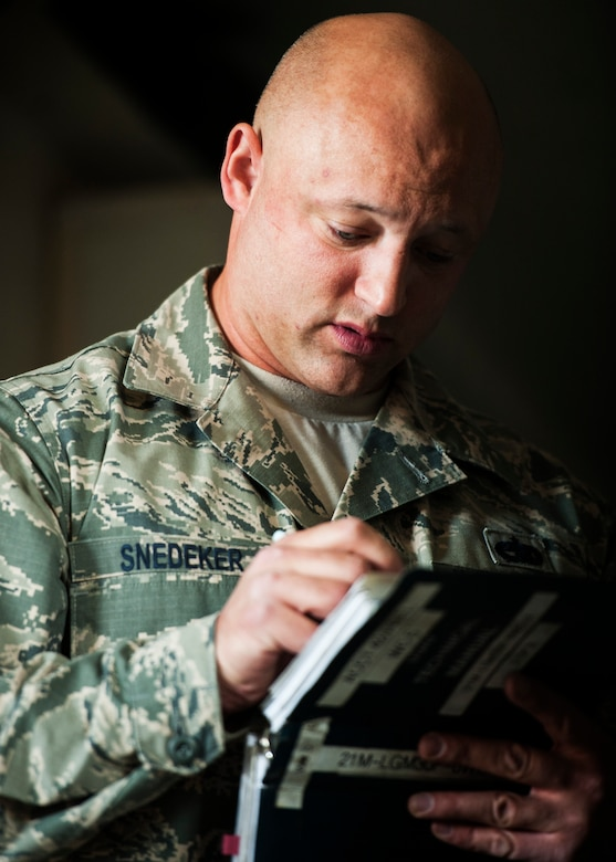 Tech. Sgt. Carl Snedeker, 91st Maintenance Group facility maintenance section site supervisor, runs through a checklist during Global Strike Challenge training at Minot Air Force Base, N.D., May 31, 2017. Snedeker is an alternate technician for the three-member PREL crew for GSC 17. (U.S. Air Force photo/Senior Airman J.T. Armstrong)