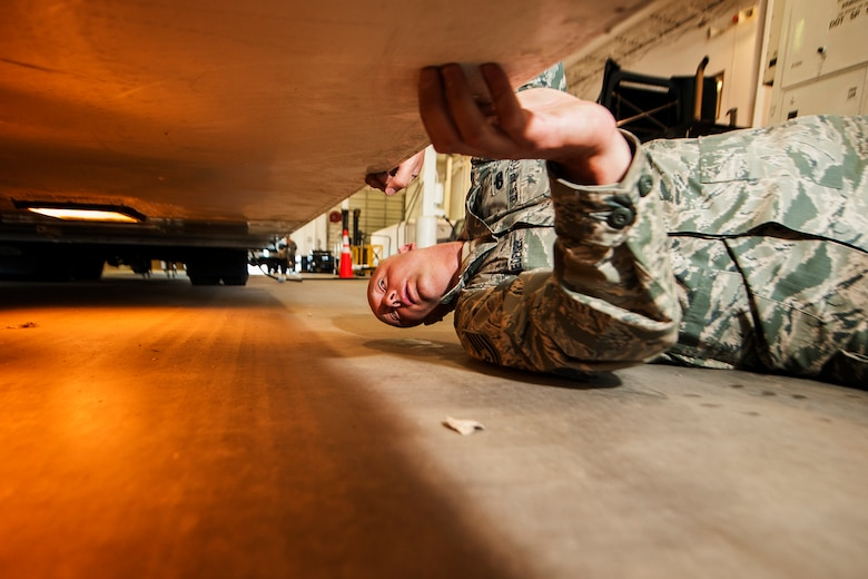 Tech. Sgt. Carl Snedeker, 91st Maintenance Group facility maintenance section site supervisor, inspects a payload transport trailer's lights during Global Strike Challenge training at Minot Air Force Base, N.D., May 31, 2017. Snedeker is an alternate technician for the three-member PREL crew for GSC 17. (U.S. Air Force photo/Senior Airman J.T. Armstrong)