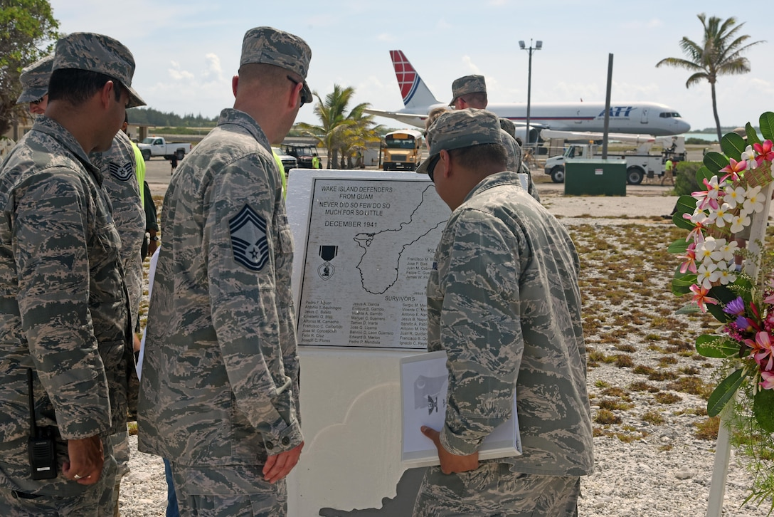 Col. Frank Flores (right), Pacific Air Forces Regional Support Center commander, Capt. Allen Jaime (left), Wake Island Det. 1 commander, PRSC, and Chief Master Sgt. David Boerman (middle), PRSC superintendent, admire the newly renovated memorial during the Guam Memorial rededication ceremony June 8, 2017. The Guam Memorial on Wake Island was erected in 1991 to honor 45 Chamorros from Guam who worked for Pan American airlines. On Dec. 8, 1941, just a few hours of the attack on Pearl Harbor, Hawaii, Japanese forces attacked Wake Island and 10 of the 45 Chamorros were killed in the attack. The remaining 35 men were sent to prison camps in Japan and China where two died in captivity. Due to decades of corrosion, heat and sun, the memorial was degraded to the point where it became unreadable. During many months in 2017, the Guam Memorial was renovated to its original glory.