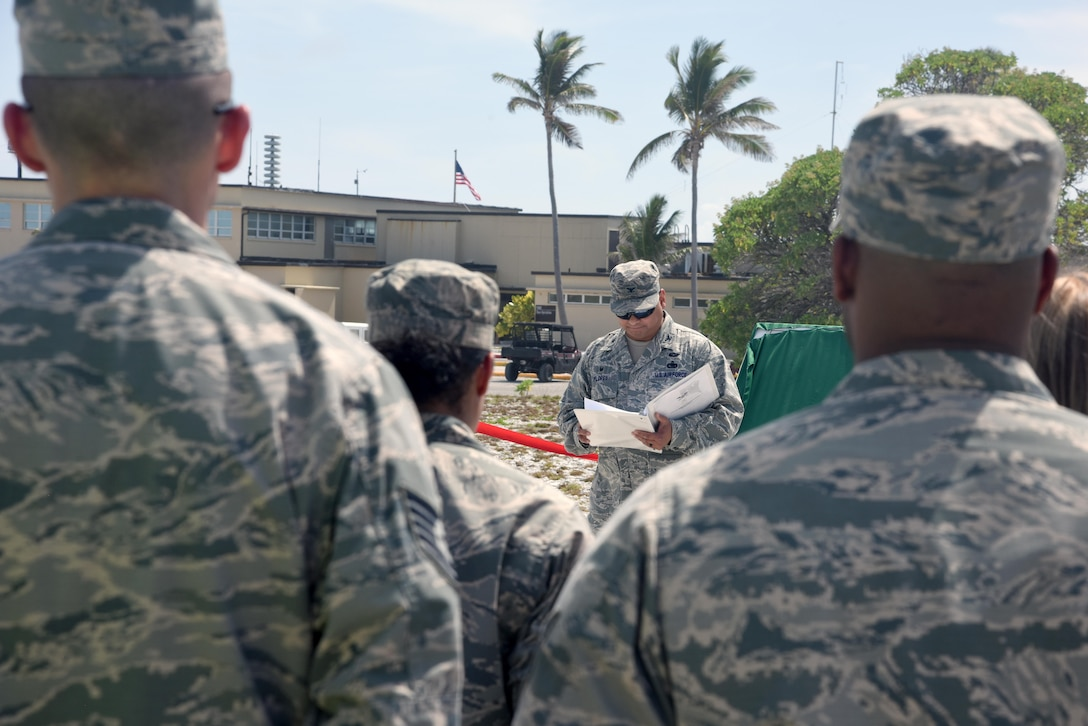 Col. Frank Flores, Pacific Air Forces Regional Support Center commander, describes the bravery and actions of 45 Chamorro men in the Battle of Wake Island during the Guam Memorial rededication ceremony June 8, 2017. The Guam Memorial on Wake Island was erected in 1991 to honor 45 Chamorros from Guam who worked for Pan American airlines. On Dec. 8, 1941, just a few hours of the attack on Pearl Harbor, Hawaii, Japanese forces attacked Wake Island and 10 of the 45 Chamorros were killed in the attack. The remaining 35 men were sent to prison camps in Japan and China where two died in captivity. Due to decades of corrosion, heat and sun, the memorial was degraded to the point where it became unreadable. During many months in 2017, the Guam Memorial was renovated to its original glory.