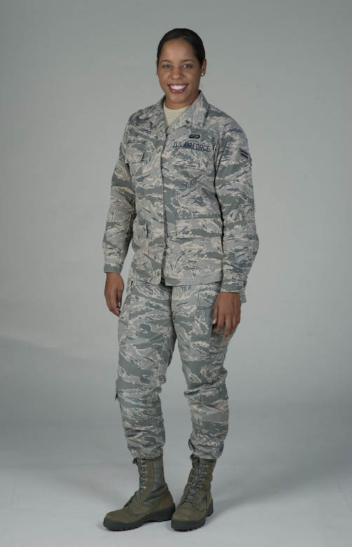 Airman 1st Class Cristine Barcellos Toffano, 60th Comptroller Squadron, poses for a photo at Travis Air Force Base, Calif., June 9, 2017. Barcellos Toffano grew up in Brazil and joined the U.S. Air Force in September 2016. As a member of the 60th CPTS, she is part of a diverse unit joining Airmen from seven different countries. (U.S. Air Force photo by Heide Couch)