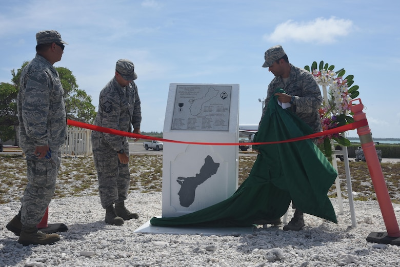 Col. Frank Flores (left), Pacific Air Forces Regional Support Center commander, and Capt. Allen Jaime (right), Wake Island Det. 1 commander, PRSC, unveil the newly renovated memorial during the Guam Memorial rededication ceremony June 8, 2017. The Guam Memorial on Wake Island was erected in 1991 to honor 45 Chamorros from Guam who worked for Pan American airlines. On Dec. 8, 1941, just a few hours of the attack on Pearl Harbor, Hawaii, Japanese forces attacked Wake Island and 10 of the 45 Chamorros were killed in the attack. The remaining 35 men were sent to prison camps in Japan and China where two died in captivity. Due to decades of corrosion, heat and sun, the memorial was degraded to the point where it became unreadable. During many months in 2017, the Guam Memorial was renovated to its original glory.
