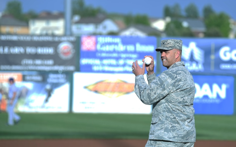 Col. Anthony Mastalir, 50th Space Wing vice commander, throws the opening pitch for Sky Sox Air Force appreciation night in Colorado Springs, Colorado, Thursday, June 8, 2017.  Mastalir represented Schriever during the event, which recognized military members. (U.S. Air Force photo/Airman 1st Class William Tracy)