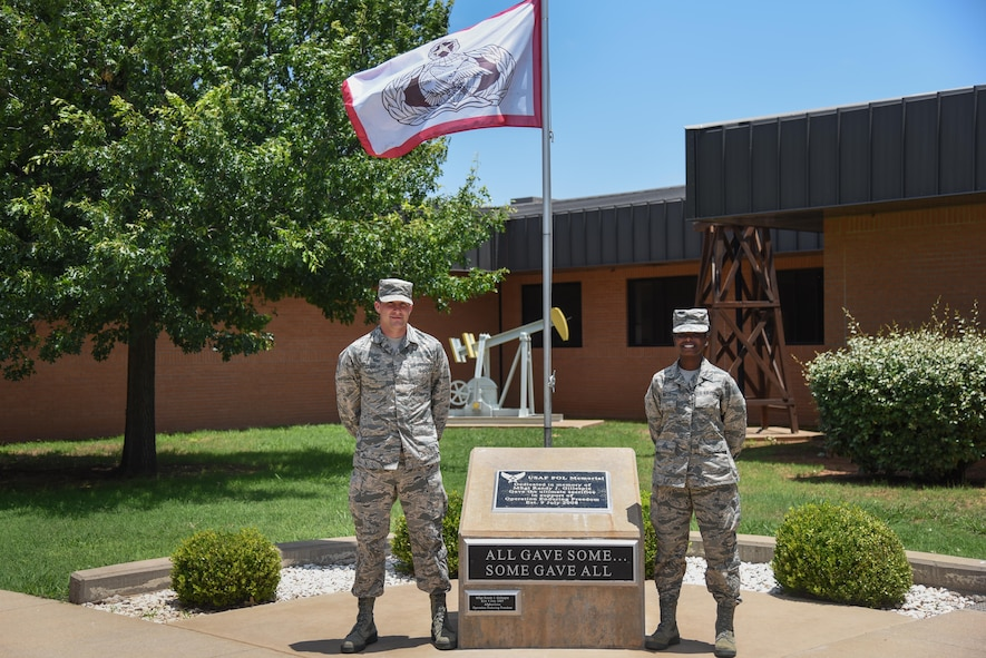 Airman Zachary LeBoeuf and Airman Ashley Watts stand proudly at the Master Sgt. Randy J. Gillespie Petroleum, Oils and Lubricants Memorial, June 13, 2017. POL Airmen in Training begin every morning outside the schoolhouse at this memorial to honor those who made the ultimate sacrifice in service to our country. (U.S. Air Force photo by Master Sgt. Joseph Speirs)