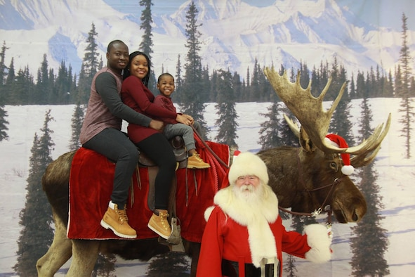 The Atchoe Family poses for a holiday photo on a stuffed moose during the winter of 2016. U.S. Air Force Staff Sgt. Francis Atchoe, a Detachment 1, 3rd Air Support Operations Squadron personnel journeyman, moved to the United States from Ghana, and Airman 1st Class Brenda Atchoe, a 354th Force Support Squadron personnel journeyman, moved from Zimbabwe. Both joined the Air Force to pursue their dreams. (Courtesy photo)