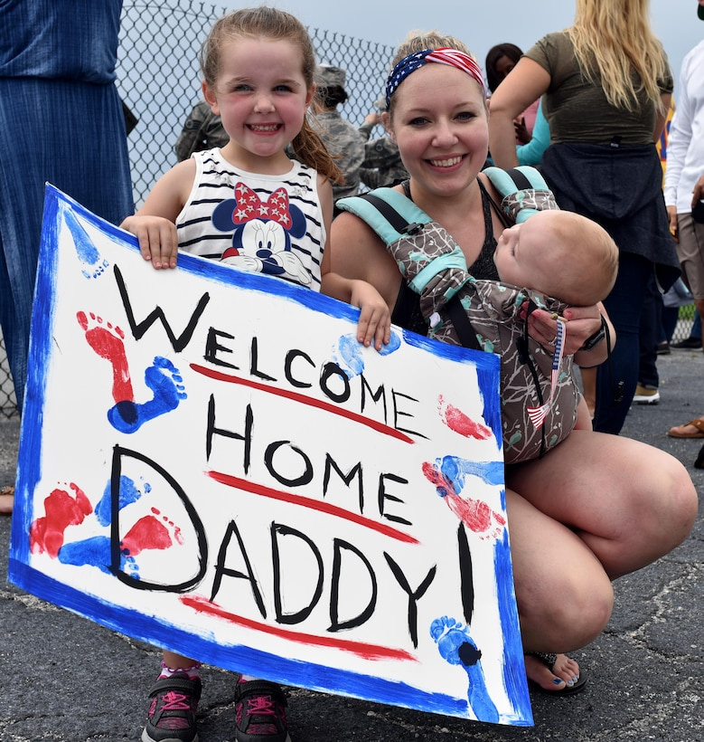 Approximately thirty Citizen Airman from the 920th Rescue Wing returned home from Afghanistan June 6 after providing personnel recovery support to ongoing operations for the last four months. Families, friends and pets gathered on base to greet their loved ones. (U.S. Air Force photo by Senior Airman Brandon Kalloo Sanes)