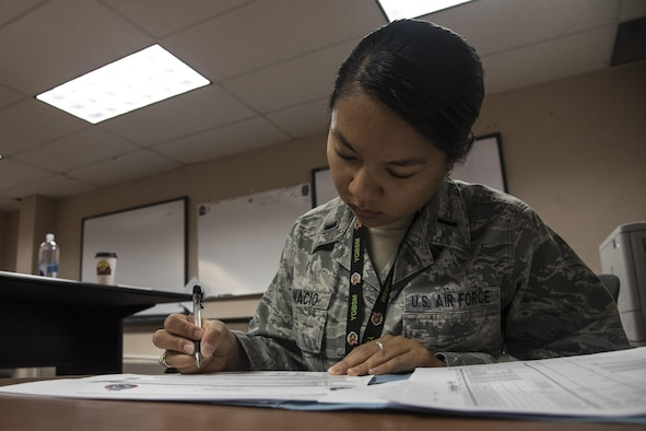 U.S. Air Force 1st Lt. Misha Ignacio, a 35th Operations Group intelligence officer out of Misawa Air Base, Japan, reviews an intelligence summary page during RED FLAG-Alaska 17-2, June 12, 2017, at Eielson Air Force Base, Alaska. The summary page includes air tasking orders as well as air operations directives used during mission planning. (U.S. Air Force photo by Airman 1st Class Sadie Colbert)
