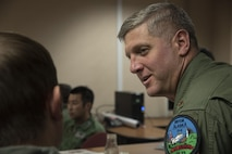 U.S. Air Force Maj. Rex Bassett, the 51st Fighter Wing assistant director of operations out of Osan Air Base, Korea, discusses plans with pilots during RED FLAG-Alaska 17-2, June 12, 2017, at Eielson Air Force Base, Alaska. Before flight, pilots gather to discuss the objectives, roles and flight tactics for a mission. (U.S. Air Force photo by Airman 1st Class Sadie Colbert)