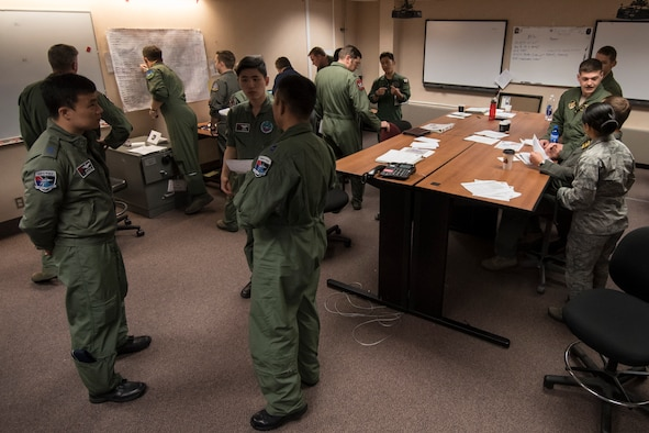 Republic of Korea Air Force, U.S. Air Force and Japan Air Self-Defense Force members begin mission planning during RED FLAG-Alaska (RF-A) 17-2, June 12, 2017, at Eielson Air Force Base, Alaska. RF-A is a two-week, multilateral large force exercise with many other nations, including Denmark, Finland and Israel, who participate to better overall tactics as one cohesive unit. (U.S. Air Force photo by Airman 1st Class Sadie Colbert)
