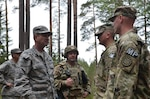 U.S. Air Force Gen. Joseph L. Lengyel, chief of the National Guard Bureau, meets with members of the 1775th Military Police Company, 210th Military Police Battalion, 177th Military Police Brigade, Michigan Army National Guard; and 3rd Battalion, 157th Field Artillery Regiment, 169th Fires Brigade, Colorado Army National Guard.
