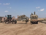 Members of the Iraqi air force and the U.S. Army 574th Combat Support Command work together to load recovered 463L pallets onto an U.S. Army truck at Al Muthana Air Base, Iraq, April 16, 2017. The pallet recovery initiative, led by aerial porters at the Baghdad Diplomatic Support Center, Iraq, involved the recovery of more than 1,500 aircraft pallets and 1,600 cargo nets, which were used for foreign military sales cargo destined for the Iraqi military to fight ISIS in Mosul. (U.S. Air Force courtesy photo)