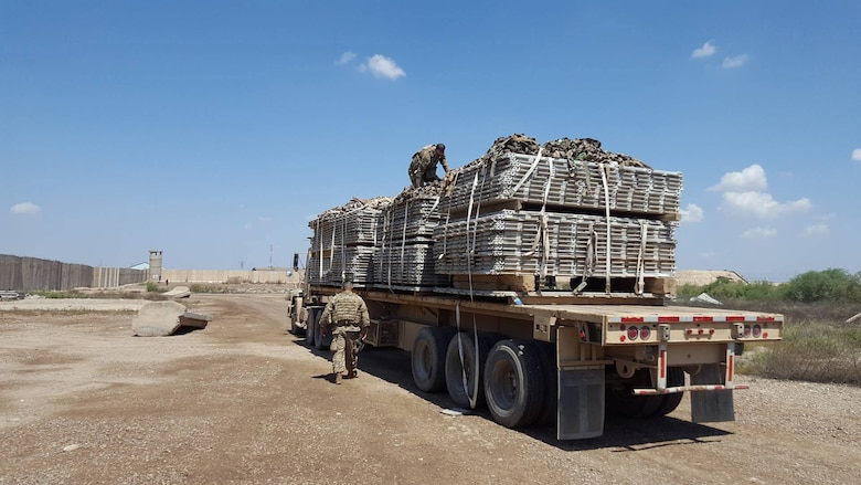 Members of the U.S. Army 574th Combat Support Command secure a load of recovered 463L pallets onto an U.S. Army truck at Al Muthana Air Base, Iraq, April 16, 2017. The pallet recovery initiative, led by aerial porters at the Baghdad Diplomatic Support Center, Iraq, involved the recovery of more than 1,500 aircraft pallets and 1,600 cargo nets, which were used for foreign military sales cargo destined for the Iraqi military to fight ISIS in Mosul. (U.S. Air Force courtesy photo)