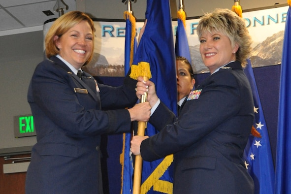 Brig. Gen. Ellen Moore (left), the HQ ARPC commander, passes the HQ RIO guidon to the organization's new commander, Col. Kelli B. Smiley, during a change of command ceremony, June 12. Smiley comes to HQ RIO after previously serving as the director of Total Force Services at HQ ARPC, which is responsible for providing personnel support to over 1 million Air Force Reserve, Air National Guard and retired Airmen.