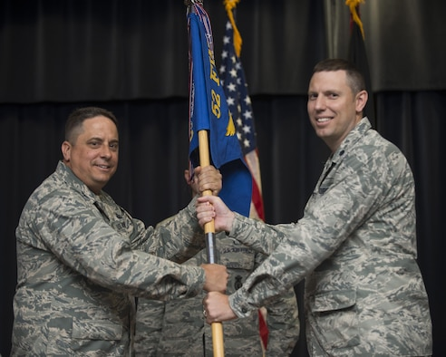 U.S. Air Force Col. Steven Zubowicz, 52nd Mission Support Group commander, left, gives the ceremonial guidon to U.S. Air Force Lt. Col. Steven Lovett, incoming 52nd Security Forces Squadron commander, during the 52nd SFS change of command ceremony on Spangdahlem Air Base, Germany, June 13, 2017. (U.S. Air Force photo by Joshua Kodis)