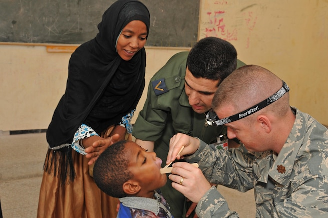 Maj. Kevin Loveridge, a physician assistant with the 151st Medical Group, provides medical care in conjunction with  Moroccan counterparts in Akka Ighane, Morocco on April 21, 2017. (U.S. Air National Guard photo by Tech. Sgt. Annie Edwards)
