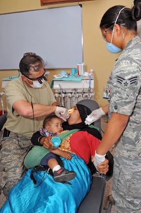 Lt. Col. Joshua Wyte, a dentist with the 140th Medical Group, and Senior Airman Skyla Spotkaeff, a dental technician with the 140th MDG provide dental care in Akka Ighane, Morocco on April 21, 2017. (U.S. Air National Guard photo by Tech. Sgt. Annie Edwards)