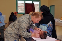 Maj. Amy Prince, a flight surgeon with the 140th Medical Group, provides medical care in the pediatric clinic in Adis, Morocco on April 22, 2017. (U.S. Air National Guard photo by Tech. Sgt. Annie Edwards)