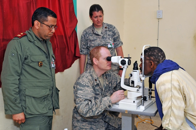 Maj. Kirk Drennan, an optometrist with the 151st Medical Group and Maj. Jessica Hegewald, an optometrist with the 140th Medical Group, provide medical care in Adis, Morocco on April 22, 2017. (U.S. Air National Guard photo by Tech. Sgt. Annie Edwards)