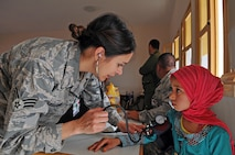 Senior Airman Holly Mclelland, a medical technician with the 151st Medical Group takes the blood pressure of a patient at the clinic in Tagmout, Morocco on April 23, 2017. (U.S. Air National Guard photo by Tech. Sgt. Annie Edwards)