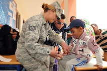 Tech. Sgt. Christina Luna, a dental technician with the 140th Medical Group provides oral hygiene education to dental patients and members of the local population at Tagmout, Morocco on April 23, 2017. (U.S. Air National Guard photo by Tech. Sgt. Annie Edwards)