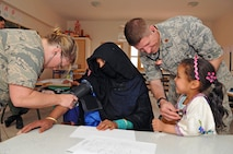 Airman 1st Class Candice Bridgewater, a medical technician with the 151st Medical Group, and Maj. David Farnsworth, a flight surgeon with the 151st MDG, provide medical care in Tagmout, Morocco on April 23, 2017. (U.S. Air National Guard photo by Tech. Sgt. Annie Edwards)