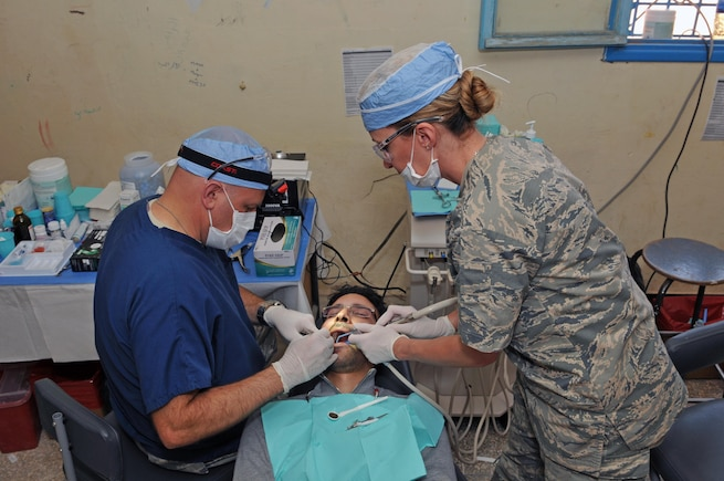 Lt. Col. Paul Anderson, a dentist with the 151st Medical Group, and Senior Airman Kristin Bentley, a dental technician with the 151st MDG, provide dental care in conjunction with their Moroccan counterparts at Issafen, Morocco on April 25, 2017 during African Lion. (U.S. Air National Guard photo by Tech. Sgt. Annie Edwards)