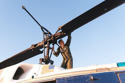 Capt. Erik Luttkus, 1st Helicopter Squadron UH-1N Iroquois pilot, inspects the blades of the helicopter at Joint Base Andrews, Md., June 9, 2017. The 1st HS conducted a flyover demonstration above the Air Force Memorial in Washington, D.C., in support of the U.S. Air Force Band's Heritage to Horizons concert series. (U.S. Air Force photo by Senior Airman Delano Scott)