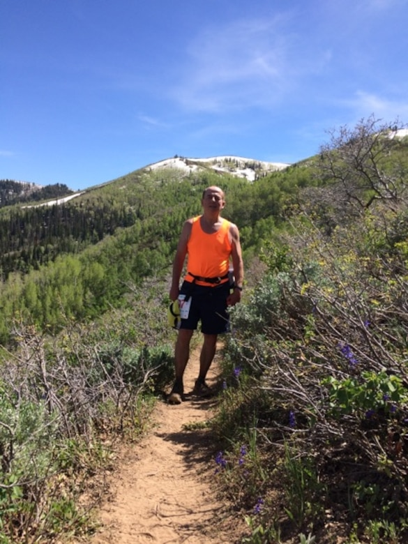 PROVO CANYON, Utah – Al Strait, 21st Space Wing director of staff, pauses on the trail of the Squaw Peak 50 Mile Adventure Run in Provo Canyon, Utah, June 3, 2017. Strait, 64, prepared for this 50 mile challenge with long Saturday morning runs and participating in other events such as the Bataan Memorial Death March. (Courtesy photo)