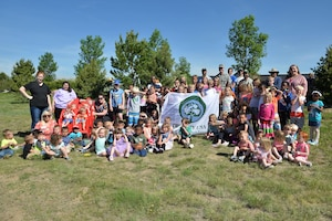 Child Development Center youth and staff celebrate Arbor Day with a tree planting courtesy of the 50th Civil Engineering Squadron and the Colorado State Forestry Service at the CDC at Schriever Air Force Base, Colorado, Friday, June 9, 2017. The planting marked the 19th consecutive year of Schriever's recognition as a Tree City USA recipient. (U.S. Air Force Photo/Dennis Rogers)