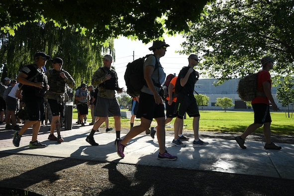 Team Hill personnel begin a ruck march from Hill Air Force Base's Memorial Park, June 9. The 10th annual ruck march honored Air Force Office of Special Investigations Special Agent (Tech. Sgt.) Ryan Balmer, who was killed in Iraq in 2007. (U.S. Air Force/R. Nial Bradshaw)