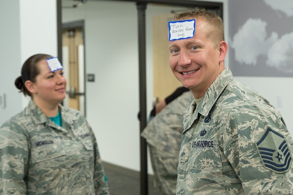 U.S. Air Force Master Sgt. John Rode wears a sign on his forhead during a brown bag lunch presentation, June 10, 2016 in Cheyenne, Wyoming. Rode and other Airmen with the 153rd Airlift Wing participated in interactive activities and listened to speakers on diversity, inclusion, and the power of mentoring. (U.S. Air National Guard photo by Senior Master Sgt. Charles Delano/released)
