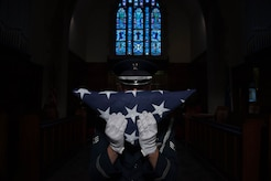 U.S. Air Force Senior Airman Luke Goins, 633rd Force Support Squadron ceremonial honor guardsman, presents the American Flag after a flag folding ceremony at Joint Base Langley-Eustis, Va., June 12, 2017. The ceremony was in honor of Flag Day, which is observed on June 14 every year. (U.S. Air Force photo/Staff Sgt. Carlin Leslie)